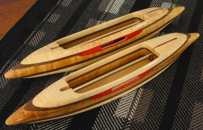 Exhibition shuttles:  fiddleback maple with pink ivory yarn-slot surrounds