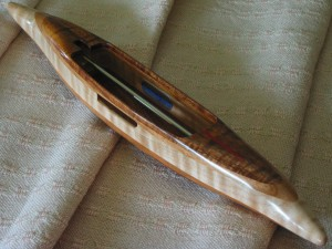 "s2015fkoa18: figured Hawaiian koa top/bottom, curly cherry 2nd layers, big leaf tiger maple center. 4.0 oz., 13""L, 1 3/4""W, 1 1/8""H, 4"" cavity end to tip. Fits 4"" bobbins."